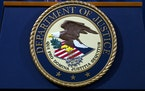 FILE - In this Nov. 28, 2018, file photo, the Department of Justice seal is seen in Washington, D.C. The Justice Department has released a new regulat