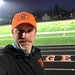 Minneapolis South High School principal Brett Stringer posed at his school's football field lit up on April 6, 2020, as part of #BethelightMN during