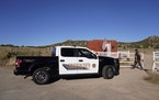 A Santa Fe County Sheriff's vehicle enters the Bonanza Creek Ranch in Santa Fe, N.M., Monday, Oct. 25, 2021. Production of the movie that Alec Baldw