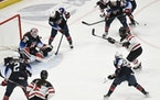 United States goaltender Nicole Hensley made a save against Canada's Laura Stacey, right, in the third period on Monday.