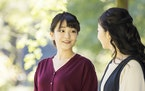 In this photo provided Saturday, Oct, 23, 2021, by the Imperial Household Agency of Japan, Japan's Princess Mako, left, the eldest daughter of Crown
