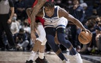Anthony Edwards (1) dribbles in the first quarter of an NBA basketball game against the New Orleans Pelicans.