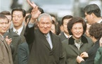 FILE - In this Dec. 22, 1997, file photo former South Korean President Roh Tae-woo, with his wife Kim Ok-sook standing beside him, waves to his suppor