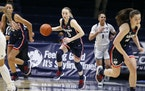 UConn guard Paige Bueckers (5) played high school basketball for Hopkins.