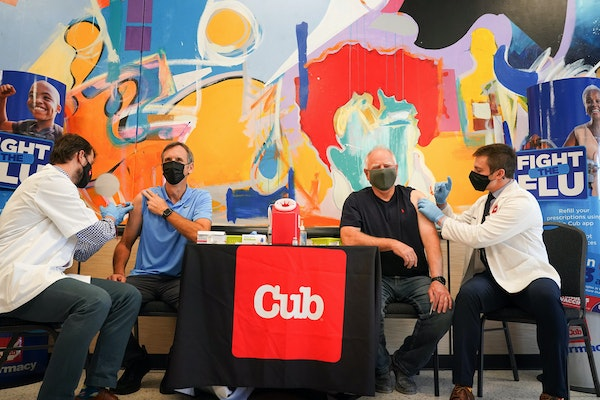 Former Gov. Tim Pawlenty and Minnesota Gov. Tim Walz received their COVID booster vaccines Tuesday at Cub Foods, Minneapolis. Giving the shots are pha