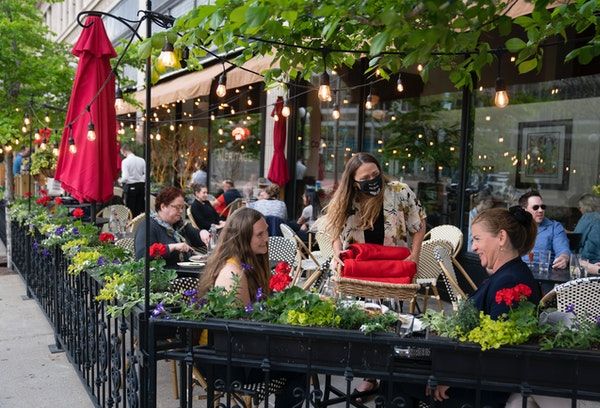 Once the weather turns cold, Meritage in St. Paul adds fire towers and blankets to its sidewalk space.