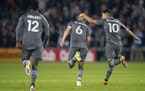 Minnesota United midfielder Emanuel Reynoso celebrates with midfielder Ozzie Alonso after Alonso scored the equalizer against Los Angeles FC