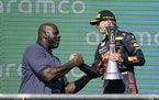 Red Bull driver Max Verstappen is congratulated by Shaquille O'Neal after winning the Formula One U.S. Grand Prix auto race in Austin, Texas