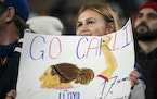 Shae Lefers, 14, of Brookings, S.D., holds a �Go Carli� sign before an international friendly between the U.S. Women's National Soccer Team and th