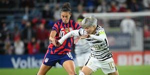 USWNT forward Carli Lloyd and South Korea midfielder Ji Soyun battle for the ball during the first half Tuesday