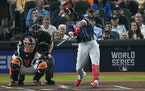 Atlanta Braves' Jorge Soler runs a home run during the first inning of Game 1 of the World Series