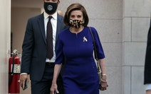 Speaker of the House Nancy Pelosi (D-Calif.), walks to a House Democrats caucus meeting Tuesday, Oct. 26, 2021 in Washington.
