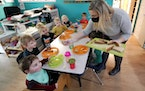 Amy McCoy serves lunch to preschoolers at her Forever Young Daycare facility, Monday, Oct. 25, 2021, in Mountlake Terrace, Wash.