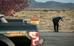 A distraught Alec Baldwin lingered in the parking lot outside the Sheriff's Office in Santa Fe County, N.M., after he was questioned about a shootin