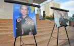 Photos of cinematographer Halyna Hutchins were displayed before a vigil held to honor her at Albuquerque Civic Plaza on Saturday, Oct. 23, 2021, in Al