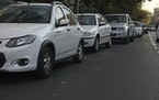 Cars line up outside a gas station in Tehran, Iran Wednesday, Oct. 27, 2021.