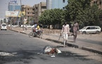 People walk on a street in Khartoum, Sudan, two days after a military coup, Wednesday, Oct. 27, 2021.
