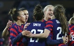 United States players celebrate a goal by Andi Sullivan (25) including, left to right, Mallory Pugh, Carli Lloyd, Sophia Smith (27) and Lindsey Horan