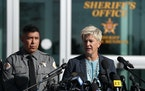 Santa Fe District Attorney Mary Carmack-Altwies speaks as Santa Fe County Sheriff Adan Mendoza, listens during a news conference Wednesday, Oct. 27, 2