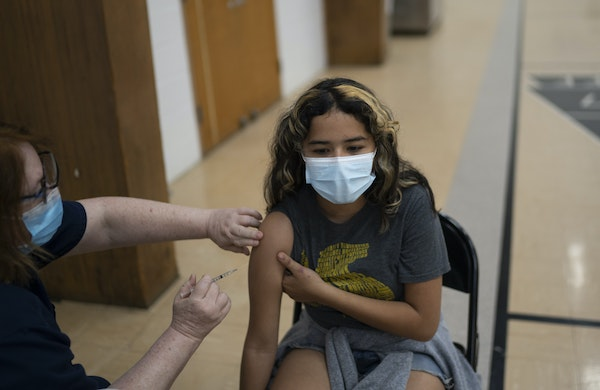About 505,000 Minnesota children ages 5-11 will become eligible for the lower-dose Pfizer vaccine when approved. Alison Alquicira, 13, received her fi