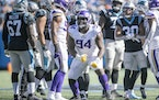 Vikings defensive tackle Dalvin Tomlinson celebrated his sack of Panthers quarterback Sam Darnold on Oct. 17. The defensive challenges grow this Sunda