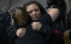 Katie Wright is hugged at a 21st birthday party for her son Wednesday, Oct. 27 at the Brooklyn Center Community Center in Brooklyn Center, Minn. Katie