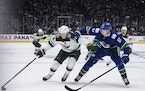 Joel Eriksson Ek of the Wild skated past Canucks defenseman Tyler Myers on Tuesday during the Wild's 3-2 victory in Vancouver.