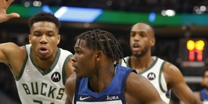 Timberwolves forward Anthony Edwards drives against Bucks forward Giannis Antetokounmpo during the first half