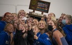Minnetonka players took their own group selfie after the trophy presentation for their Class 2A championship Wednesday, Oct. 27, 2021 in Minneapolis.