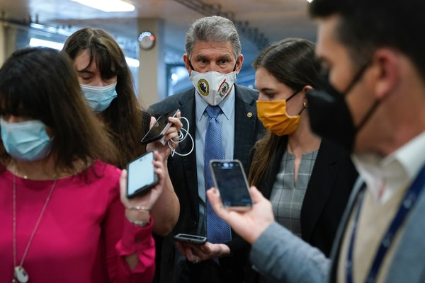 Sen. Joe Manchin, D-W.Va., spoke with reporters Wednesday on Capitol Hill in Washington. President Joe Biden is expected to speak this morning to the