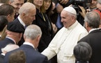 FILE - In this April 29, 2016, file photo Pope Francis shakes hands with Vice President Joe Biden as he takes part in a congress on the progress of re
