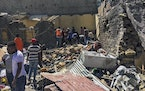 Residents sift through rubble from a destroyed building at the scene of an airstrike in Mekele, in the Tigray region of northern Ethiopia Thursday, Oc