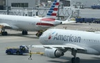 American Airlines passenger jets at Boston Logan International Airport in July.