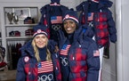 Snowboarder Jamie Anderson, left, and bobsledder Aja Evans model the Team USA Beijing winter Olympics closing ceremony uniforms designed by Ralph Laur