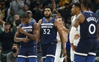 Minnesota Timberwolves forward Anthony Edwards (1) reacts with Minnesota Timberwolves center Karl-Anthony Towns (32) in the closing moments of an NBA