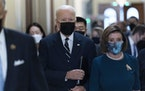 President Biden walks with Speaker of the House Nancy Pelosi on Capitol Hill in Washington, Thursday, Oct. 28, 2021, during a visit to meet with House