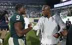 Michigan State coach Mel Tucker, right, congratulated the Big Ten's leading rusher, Kenneth Walker III, earlier this season.