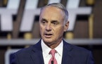 FILE - In this July 11, 2021, file photo, Major League Baseball Commissioner Rob Manfred kicks off the first round of the 2021 MLB baseball draft in D