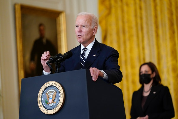 President Joe Biden speaks about his domestic agenda today from the East Room of the White House as Vice President Kamala Harris looks on.