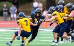 Jordan Embry, middle, has rushed for 712 yards and seven touchdowns for St. Olaf.