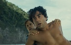 "Gael García Bernal and Alex Wolff in ""Old."""